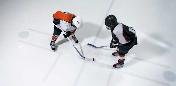 Young hockey players in a face off