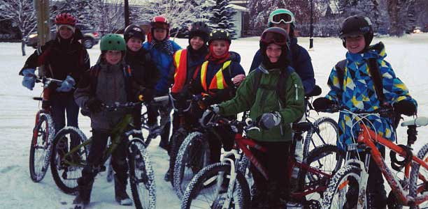 Photo of Calgary kids biking in the winter by Tom Babin