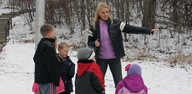 Stacy Irvine leads some children in some outdoor skill building activities.
