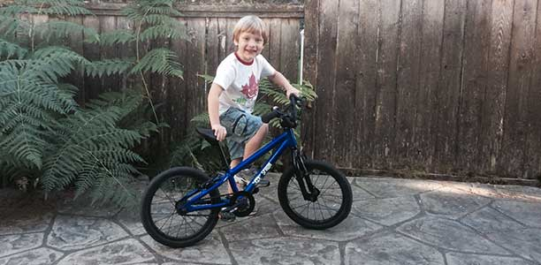 Owen and his first bike, a Spawn Banshee