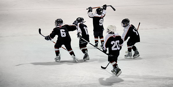 In Québec, kids don't play hockey games until they have the skills