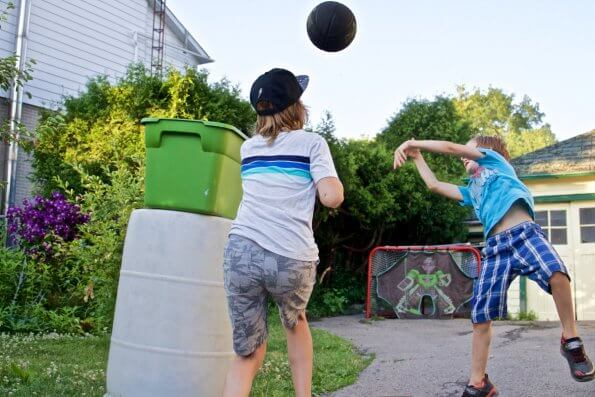 Writer's sons playing with makeshift basketball net.