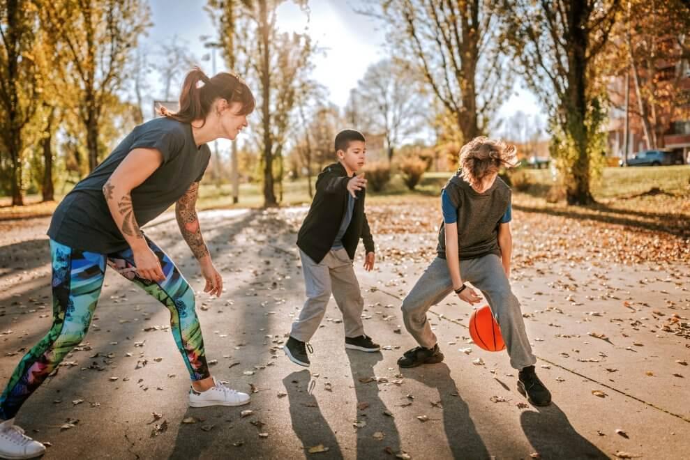 mom and boys playing basketball