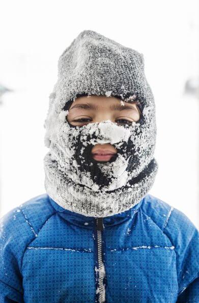 Boy wearing balaclava on snowy day